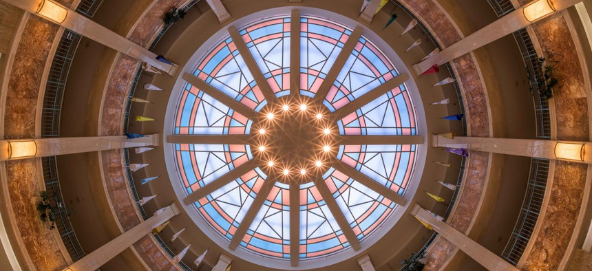The stained glass window ceiling from the rotunda floor of the New Mexico state Capitol in Santa Fe.