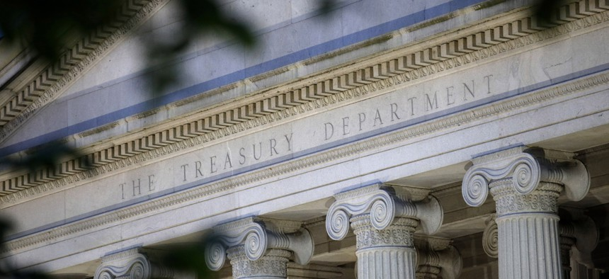 This June 6, 2019, file photo shows the U.S. Treasury Department building at dusk in Washington.