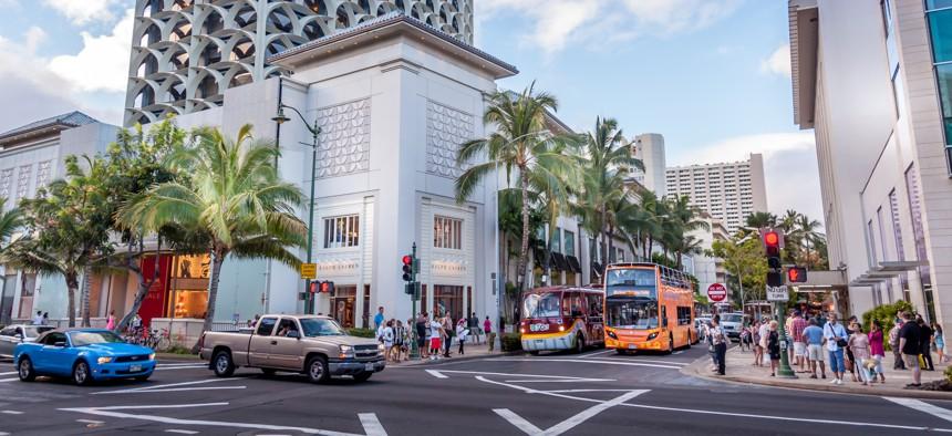 Famous Kalakaua Avenue in the evening in Waikiki, Hawaii.