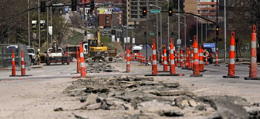 In this March 30, 2021 file photo, workers replace old water lines under Main Street as part of work to update water and sewer systems as well as prepare the road for the expansion of a street car line in Kansas City, Mo. Water infrastructure is one way communities can spend American Rescue Plan Act aid.