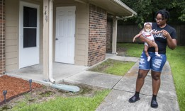 Tyesha Young, who lost her hospital job during the pandemic, holds her baby Jalayah Johnson outside their home in Waggaman, La., Friday, July 2, 2021. More than $7,000 behind on rent, Young hopes a program in Louisiana would bail her out and allow her family to avert eviction in the coming weeks.