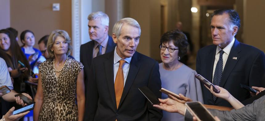 Sen. Rob Portman, R-Ohio, center, joined by, from left, Sen. Lisa Murkowski, R-Alaska, Sen. Bill Cassidy, R-La., Sen. Susan Collins, R-Maine, and Sen. Mitt Romney, R-Utah, announces to reporters that he and the other GOP negotiators have reached agreement on a $1 trillion infrastructure bill with Democrats.