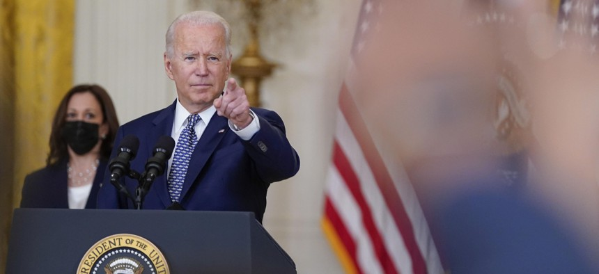 President Joe Biden gestures as he takes questions from members of the media after speaking about the bipartisan infrastructure bill from the East Room of the White House, Tuesday, Aug. 10, 2021, in Washington. Vice President Kamala Harris listens at left.