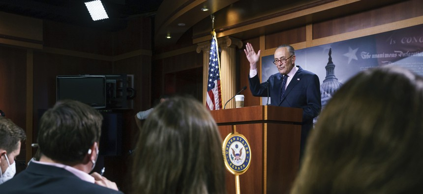 """Senate Majority Leader Chuck Schumer, D-N.Y., meets with reporters after a marathon """"vote-a-rama"""" to advance President Joe Biden's federal priorities, at the Capitol in Washington, Wednesday, Aug. 11, 2021."""