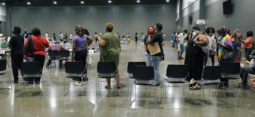 Applicants at a rental assistance fair for Jackson residents at the Mississippi Trademart, line up to be assigned the proper station in the state Fairgrounds, Saturday, July 24, 2021, in Jackson, Miss.