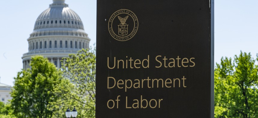In this May 7, 2020, file photo, the entrance to the Labor Department is seen near the Capitol in Washington. Unemployment fraud in the U.S. has reached dramatic levels during the pandemic.