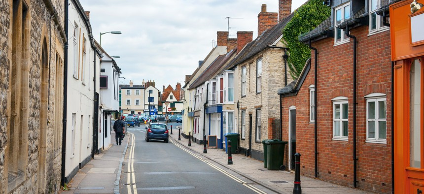 The report says that many urban streets in Europe, like this one in England, are narrow to accommodate more housing.