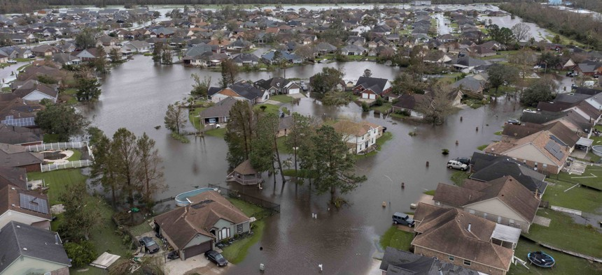 Flooded streets and homes are shown in the Spring Meadow subdivision in LaPlace, La., after Hurricane Ida moved through Monday, Aug. 30, 2021.