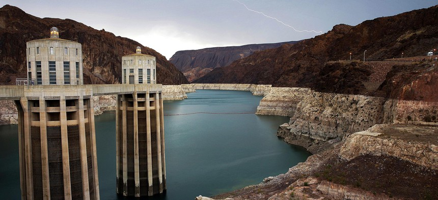 In this July 28, 2014, file photo, lightning strikes over Lake Mead near Hoover Dam that impounds Colorado River water at the Lake Mead National Recreation Area in Arizona.
