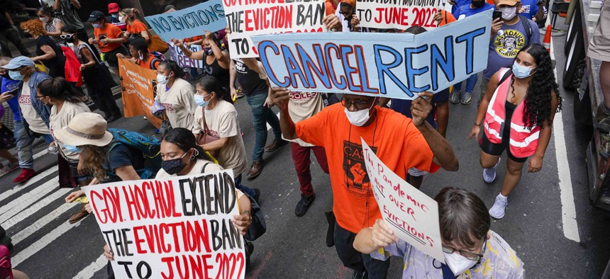 Activist march across town towards New York Gov. Kathy Hochul office, Tuesday, Aug. 31, 2021, in New York, during a demonstration to call on Hochul, Speaker Carl Heastie, and Senate Majority Leader Andrea Stewart-Cousin to extend pandemic era eviction protections in wake of Supreme Court decision lifting the moratorium.