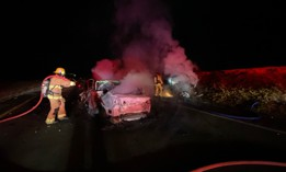 Santa Barbara County Fire crews extinguish fires from a two vehicle, triple fatal accident that happened on Highway US 101 north of Goleta, Calif., early Wednesday, Aug. 25, 2021.