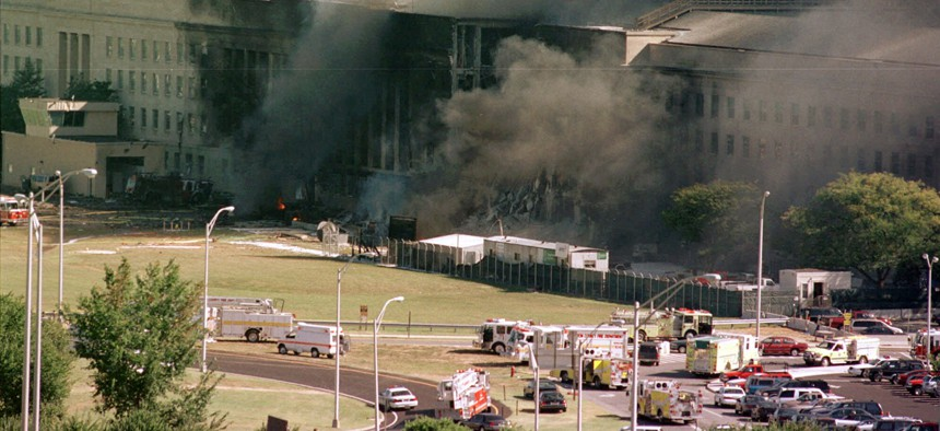 In this Sept. 11, 2001 file photo, the south side of the Pentagon burns after a plane crash in Washington.