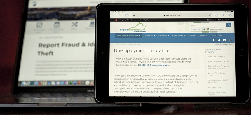 Web pages used to show information for collecting unemployment insurance in Virginia, right, and reporting fraud and identity theft in Pennsylvania, are displayed on the respective state web pages, Friday, Feb. 26, 2021.