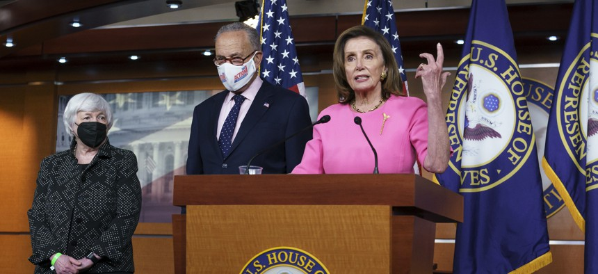 """Speaker of the House Nancy Pelosi, D-Calif., joined from left by Treasury Secretary Janet Yellen and Senate Majority Leader Chuck Schumer, D-N.Y., updates reporters on Democratic efforts to pass President Joe Biden's """"Build Back Better"""" agenda, at the Capitol in Washington, Thursday, Sept. 23, 2021."""