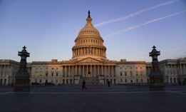 """The Capitol is seen at dawn as a consequential week begins in Washington for President Joe Biden and Democratic leaders in Congress who are trying to advance his $3.5 trillion """"Build Back Better"""" and pass legislation to avoid a federal shutdown, Monday, Sept. 27, 2021."""