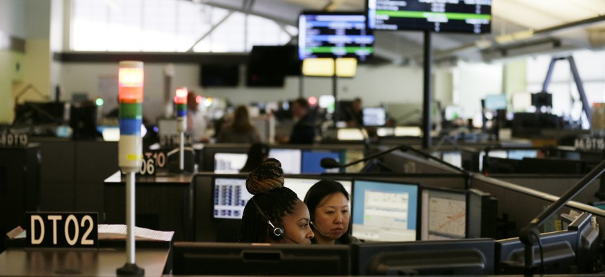 In this photo taken Aug. 2, 2019, is the 9-1-1 call center at the San Francisco Department of Emergency Management in San Francisco.