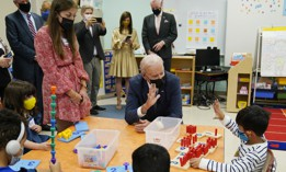 """President Joe Biden talks to students during a visit to East End Elementary School to promote his """"Build Back Better"""" agenda, Monday, Oct. 25, 2021, in North Plainfield, N.J."""