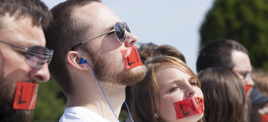 Advocates rally outside the U.S. Supreme Court while waiting for the court's decision in the Burwell v. Hobby Lobby case in June.
