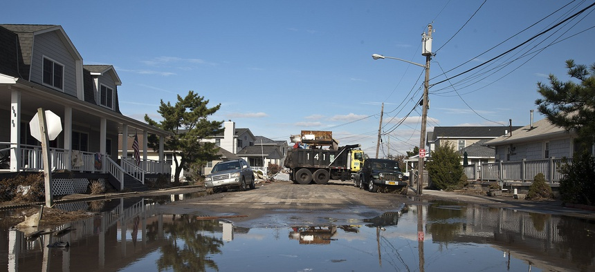 New York City Department of Transportation work crews assist in the clean-up efforts in Breezy Point, Queens, following Superstorm Sandy.