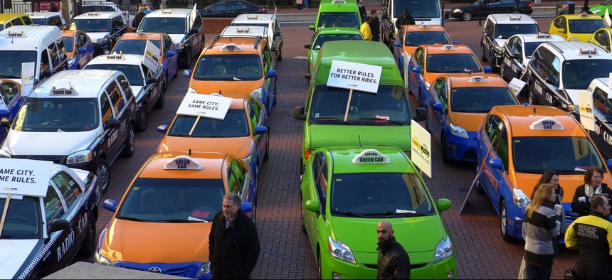 Around 70 of Portland, Oregon's 460 cabbies protested ride-sharing companies like Uber in January by parking in Pioneer Square.