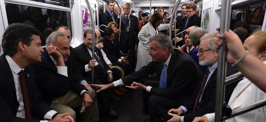 Elected officials take the ceremonial first train Sunday on the 7 line out of the newly dedicated 34 St-Hudson Yards station.