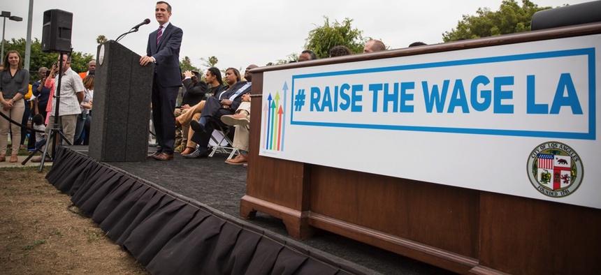 Mayor Eric Garcetti signing Raise the Wage legislation earlier this year.