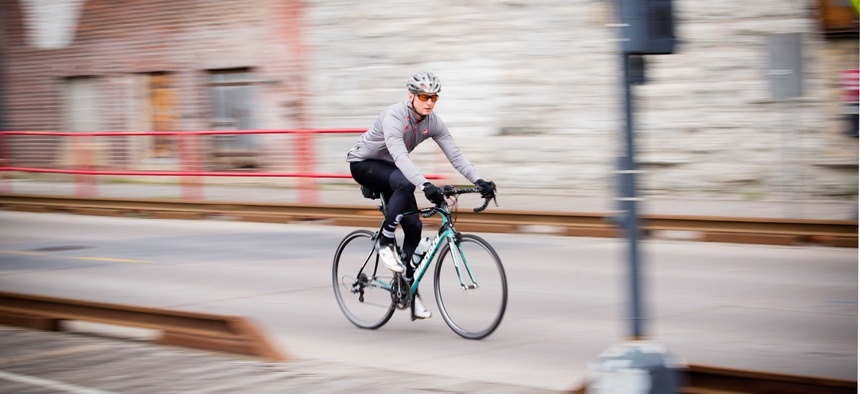 A man rides a bicycle in Minneapolis, Minnesota in May of 2017.