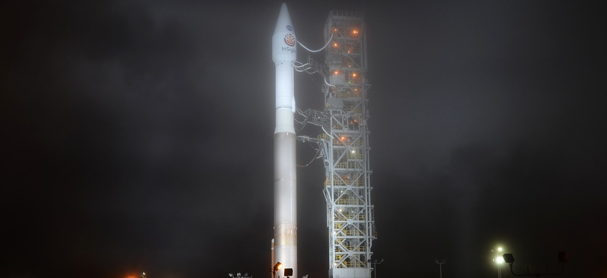 Vandenberg Air Force Base, CA-May 4, 2018: An Atlas V rocket stands ready as fog begins to roll in several hours before the launch of the InSight Mars lander into space at 4:05 a.m.