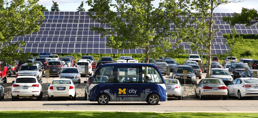 An Mcity driverless shuttle drives at the University of Michigan in Ann Arbor.