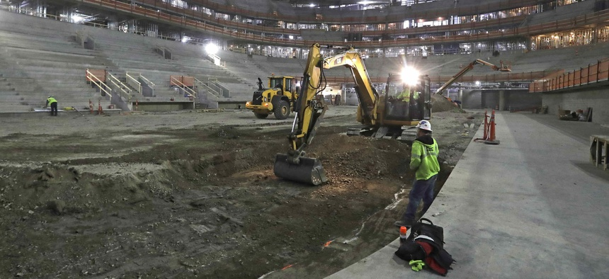 In this Jan. 3, 2017, file photo, workers begin excavation for an arena in Detroit that tax increment financing was used to help develop.
