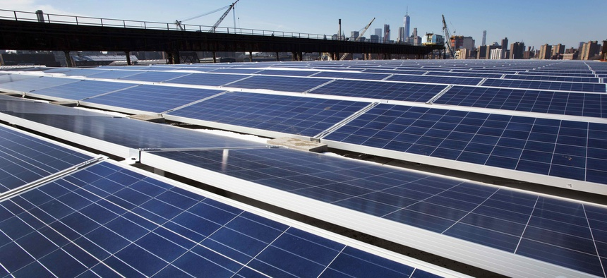 In this Feb. 14, 2017, file photo, a rooftop is covered with solar panels at the Brooklyn Navy Yard, Tuesday, Feb. 14, 2017, in New York.
