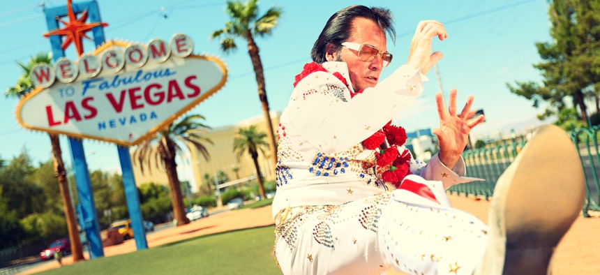 An Elvis impersonator at the 'Welcome to Fabulous Las Vegas' sign, an enduring brand.