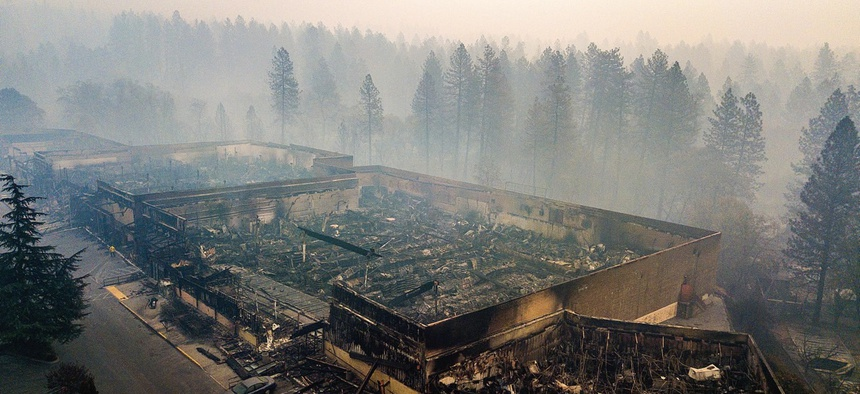 Smoke hangs over the scorched remains of Old Town Plaza following the wildfire in Paradise, California.