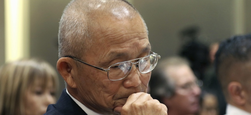 In this Jan. 19, 2018 file photo, former Hawaii Emergency Management Agency Administrator Vern Miyagi listens during a hearing with state lawmakers about a mistaken missile alert in Honolulu.
