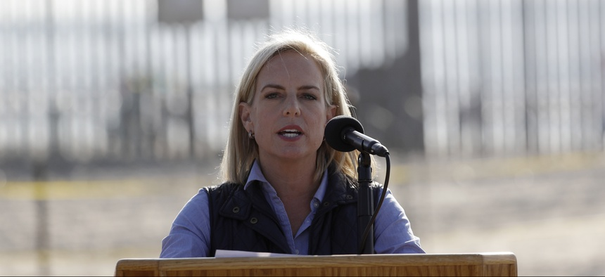 Secretary of Homeland Security Kirstjen Nielsen speaks in front of the border wall separating Tijuana, Mexico, and San Diego, Tuesday, Nov. 20, 2018, in San Diego.