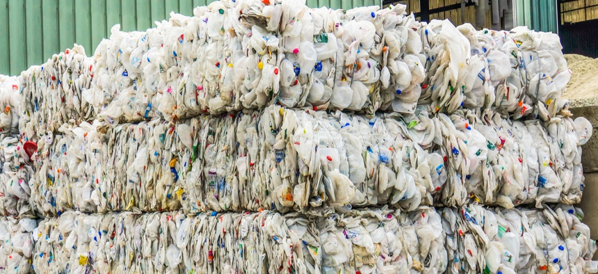 Clear plastic milk jugs baled for recycling at a recycling facility in Williston, Vermont.