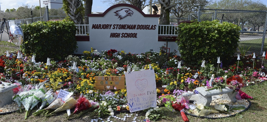 Students and parents visit a make shift memorial setup at Marjory Stoneman Douglas High School in honor of those killed during a mass shooting to mark the one year anniversary on Feb. 14, 2019.