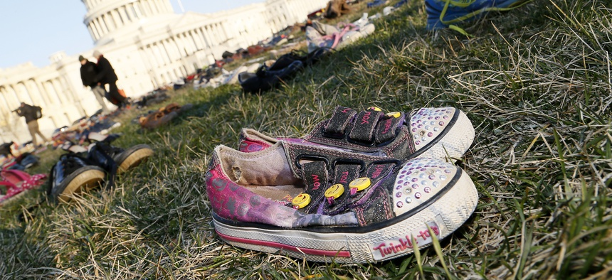 In front of the U.S. Capitol building, survivors, family members and volunteers place 7,000 empty pairs of shoes for every child killed by guns in the U.S. since Sandy Hook on March 13, 2018.