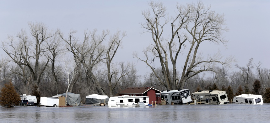 Flooded RV's, washed away by the flood waters of the Platte River, are seen in Merritt's RV Park in Plattsmouth, Neb., Sunday, March 17, 2019.