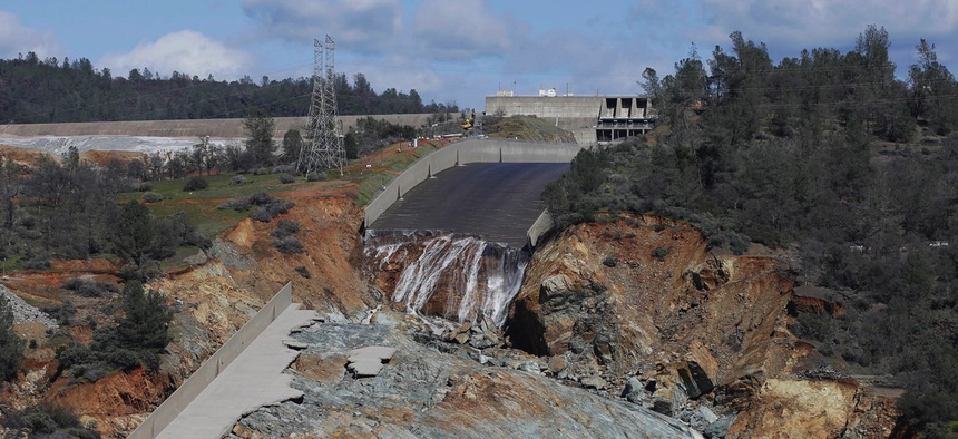 A small flow of water goes down Oroville Dam's crippled spillway on Feb. 28, 2017, in Oroville, California.