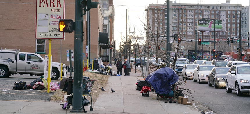 People experiencing homelessness tend to live in certain pockets of Denver's downtown, including this section of Champa Street. This is also an area where people experiencing homelessness frequently encounter police.