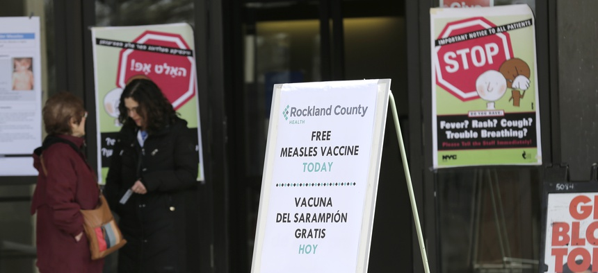 Signs about measles and the measles vaccine are displayed at the Rockland County Health Department in Pomona, N.Y. on March 27, 2019. County officials declared a state of emergency and banned unvaccinated children from inside public places.