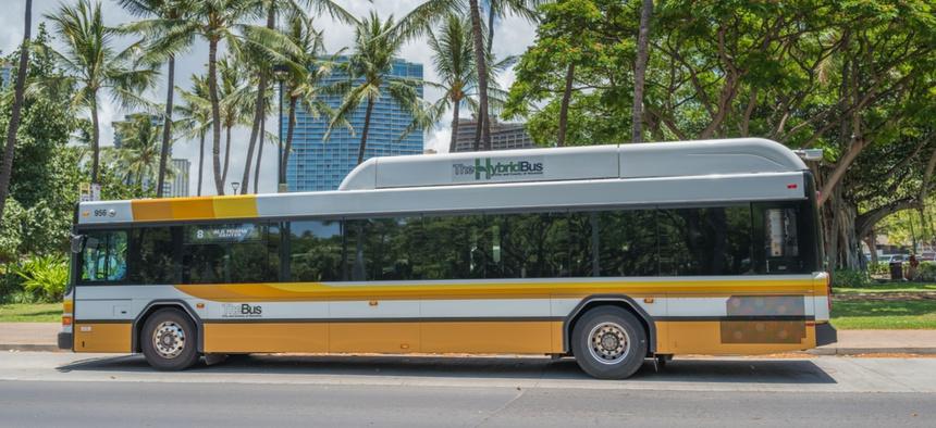 A hybrid bus on Hawaii's street.