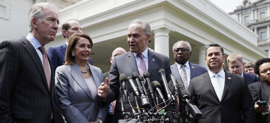 Speaker of the House Nancy Pelosi of Calif., Senate Minority Leader Sen. Chuck Schumer of N.Y. and other Democrats, talk to the media after meeting with President Donald Trump in the Cabinet Room of the White House, Tuesday, April 30, 2019, in Washington.