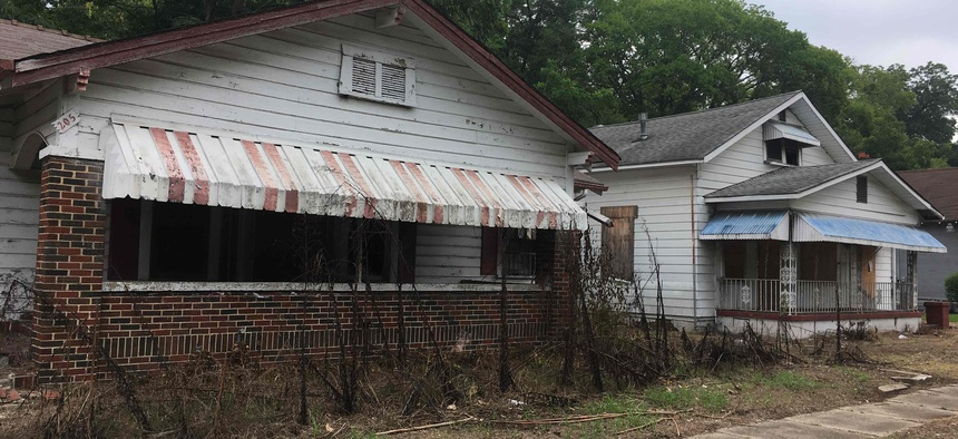 Dilapidated houses line a street inside an opportunity zone in Birmingham, Alabama.