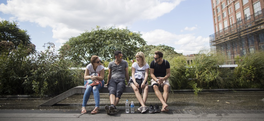 Visitors take a break on one of the High Line's benches in the Meatpacking District neighborhood of Manhattan.