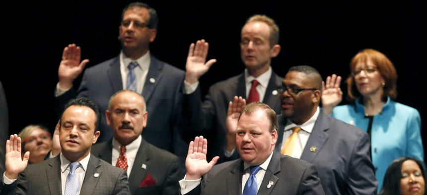 Newly elected aldermen take the oath of office in 2015.