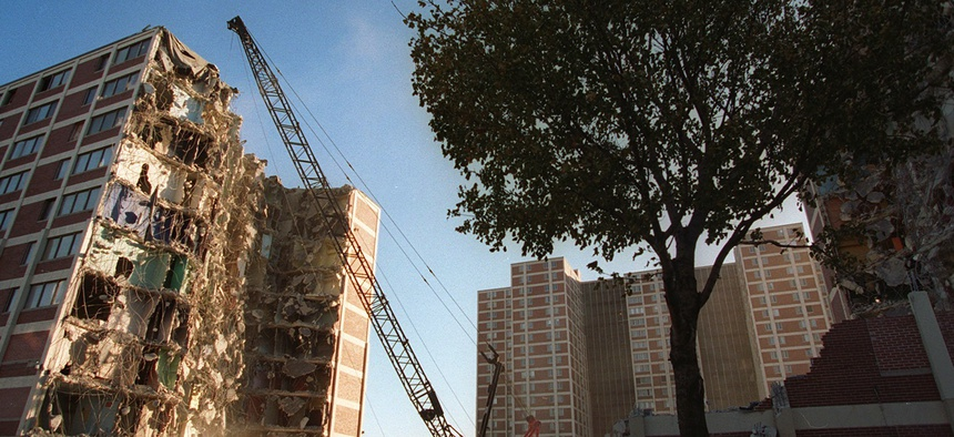 In this Wednesday, Nov. 8, 1995, file photo, a wrecking ball tears away at one of several Cabrini-Green public housing project buildings in Chicago.