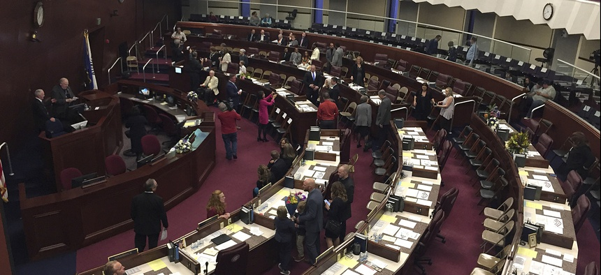 Assembly members gather before the Nevada State Assembly in Carson City, Nevada, in February 2019.