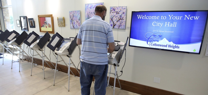 A voter in August 2017 casts his vote in Cottonwood Heights, Utah.